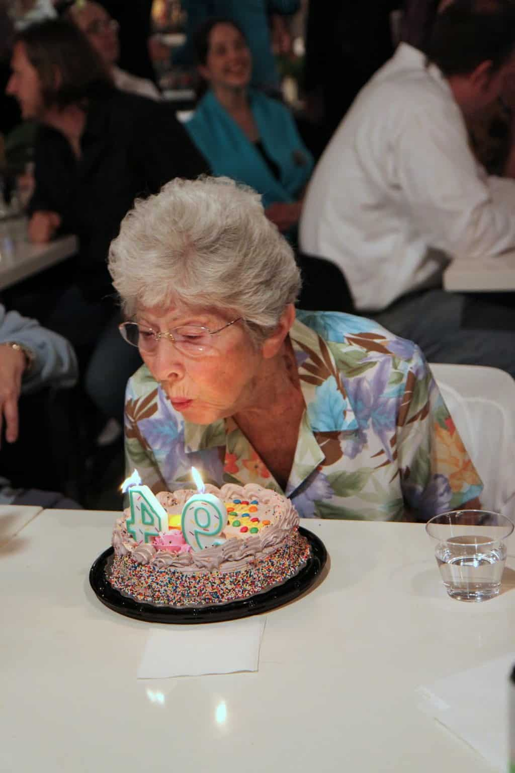 Martha Sigall blows out birthday candles at Artworks- Happy 94th Martha!