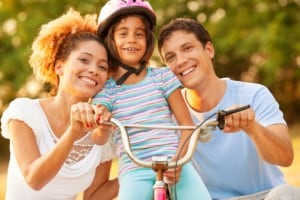 171262031-family-having-fun-with-bike-outdoors-gettyimages