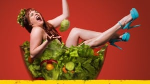1439911234-woman_laughing_alone_in_salad_tickets