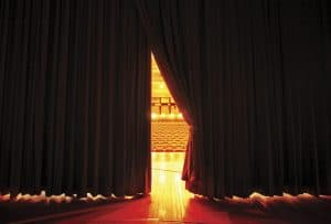 Moving Stage Curtains, as seen as Actors on Stage.