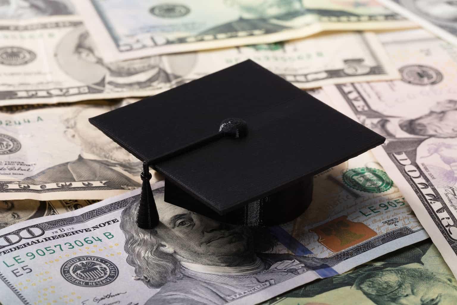 Graduation Cap On Dollar Banknotes